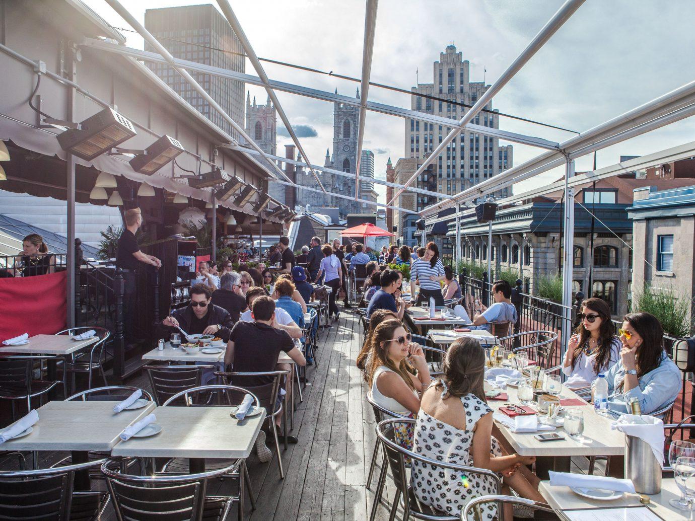 Trip Ideas building outdoor restaurant people City crowd