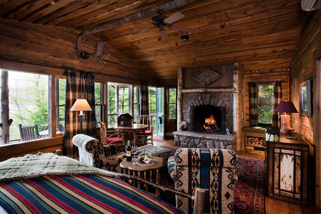 Cabin cozy Fireplace living room Lodge Lounge natural light Nature Outdoors remote Romance sunlight trees Trip Ideas warm indoor ceiling room Living window property estate log cabin building house home fire cottage farmhouse real estate Villa wood interior design porch mansion Resort furniture decorated area stone