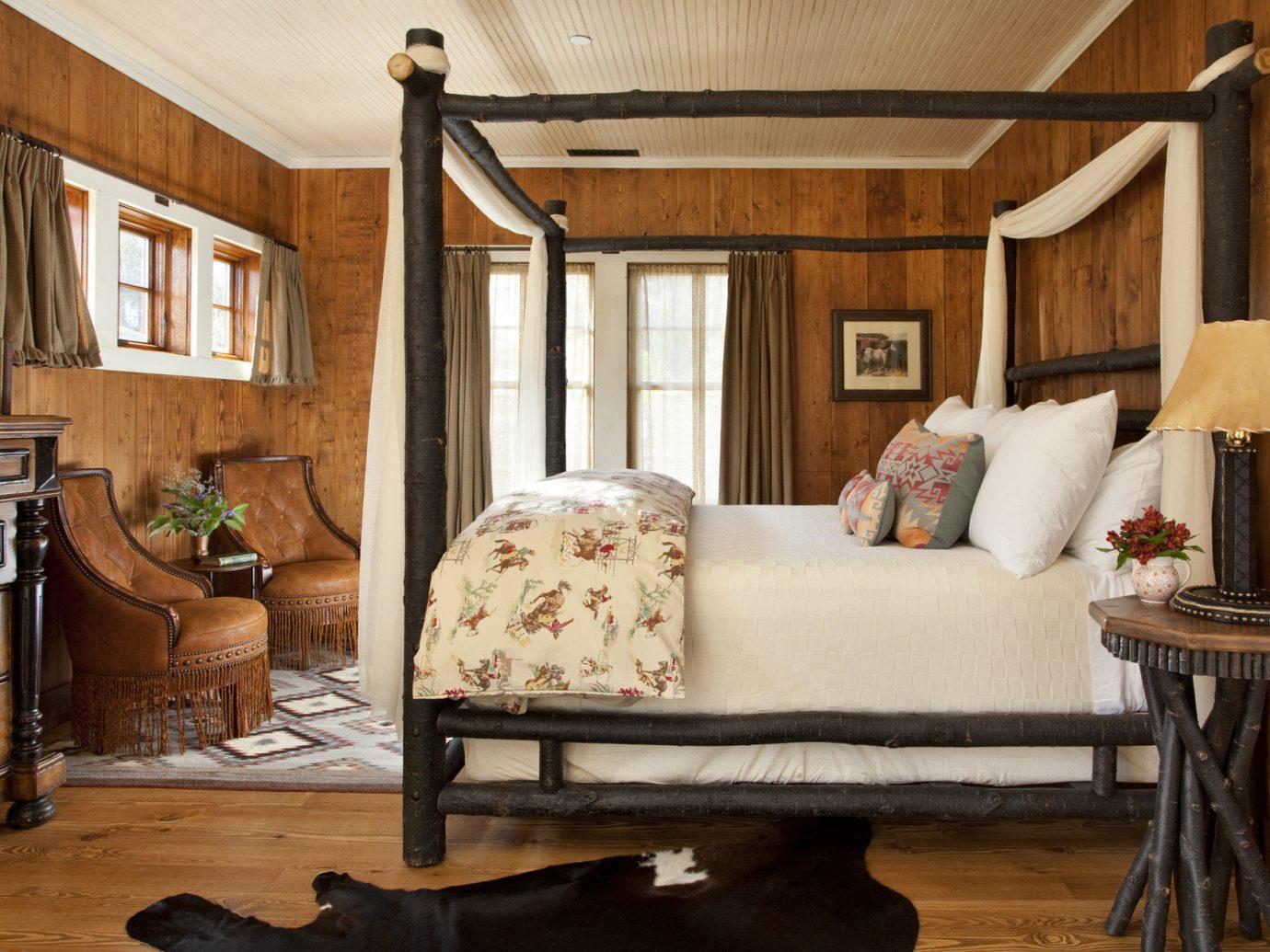 Hotels Trip Ideas indoor floor Living room living room property home house furniture hardwood wood estate cottage interior design farmhouse bed Bedroom table area