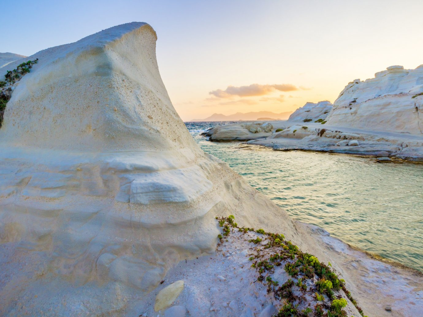 Trip Ideas outdoor sky Nature mountain shore landform Coast geographical feature Sea natural environment cliff water Ocean rock wave badlands wind wave terrain sand landscape Beach geology cape ice material hillside
