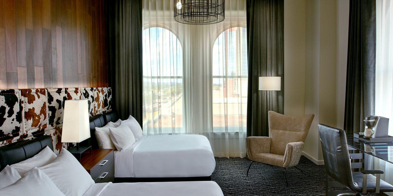 Boutique Hotels Trip Ideas indoor window room sofa floor property Living bed Suite living room interior design hotel estate furniture condominium Design Bedroom decorated
