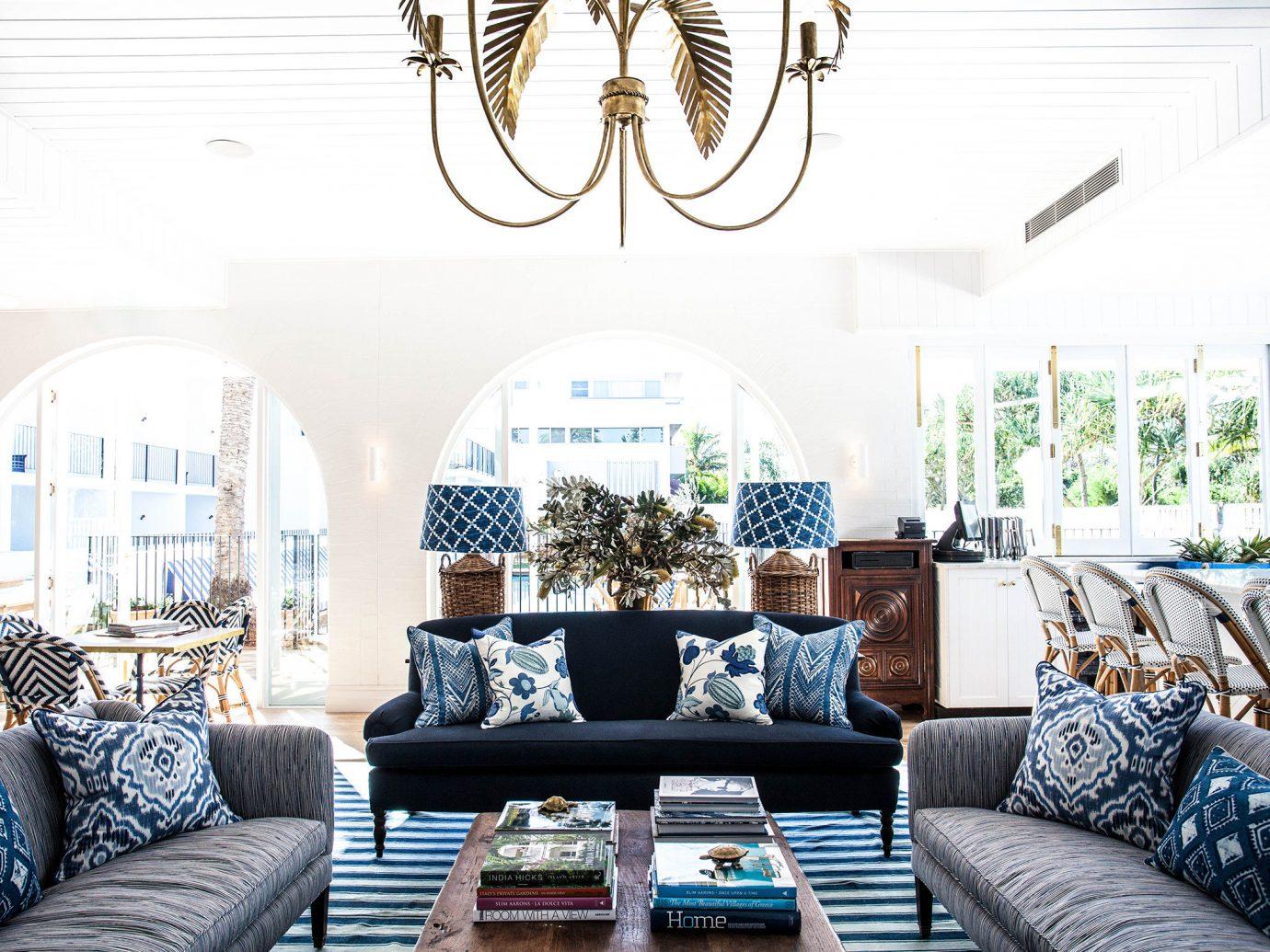 Beach Trip Ideas Living sofa indoor room window living room property home furniture estate interior design decorated real estate Design condominium area
