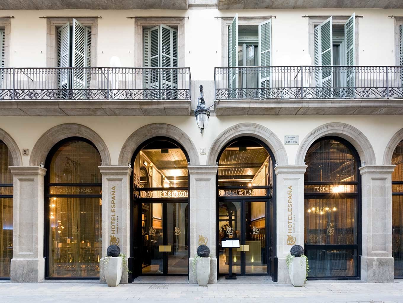 Boutique Hotels Buildings City Hip Historic Hotels building outdoor Architecture urban area arcade facade Downtown estate arch window palace tourist attraction stone colonnade