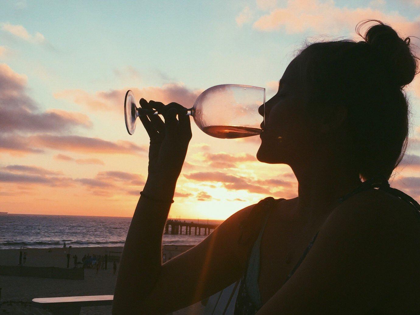 Style + Design person sky Sea sunglasses water vacation glasses cloud photography reflection sunrise horizon vision care Sunset evening eyewear sunlight fun girl summer silhouette calm Beach Sun Ocean backlighting clouds dark