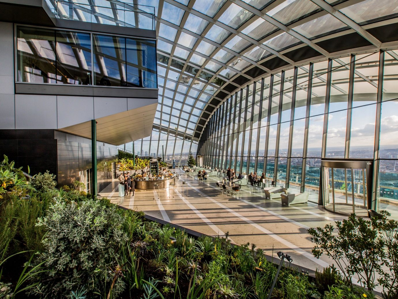 Arts + Culture Trip Ideas building Architecture greenhouse outdoor structure headquarters Courtyard court walkway roof