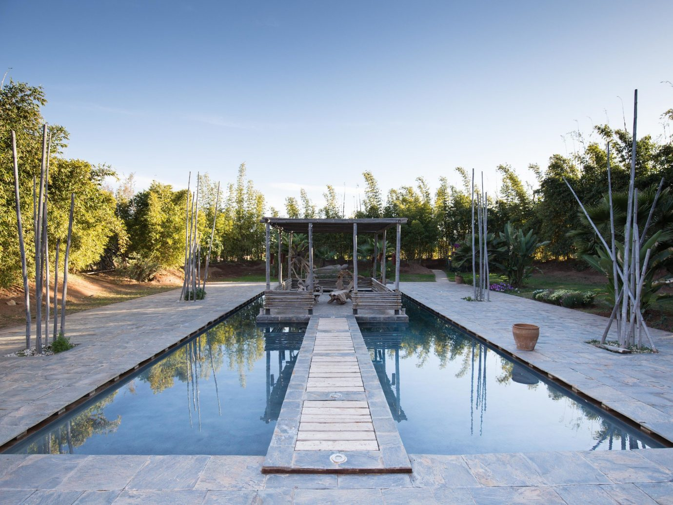 Hotels Solo Travel sky tree outdoor swimming pool leisure walkway estate reflecting pool dock Resort reflection backyard way lined