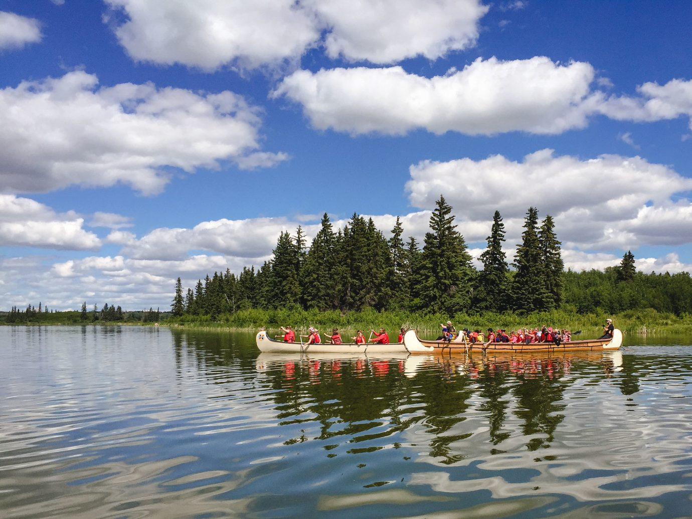 Alberta Canada Road Trips reflection cloud sky waterway water Nature body of water Lake tree loch Boat River reservoir water transportation bank wetland shore water resources bayou landscape vehicle plant lake district inlet pond meteorological phenomenon watercraft rowing boating calm