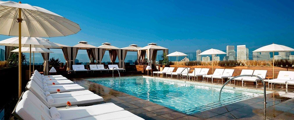 Hotels umbrella outdoor sky chair water swimming pool leisure Resort property swimming blue vacation Pool estate Villa resort town caribbean accessory lined Deck day shore