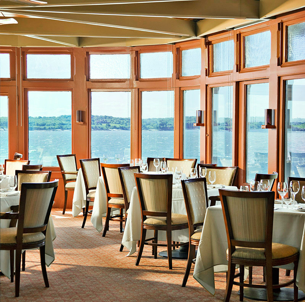 Classic Dining Drink Eat Hotels Inn Luxury Scenic views Waterfront chair table floor indoor room property dining room restaurant estate ceiling home interior design wood Resort Design window covering condominium living room furniture several dining table