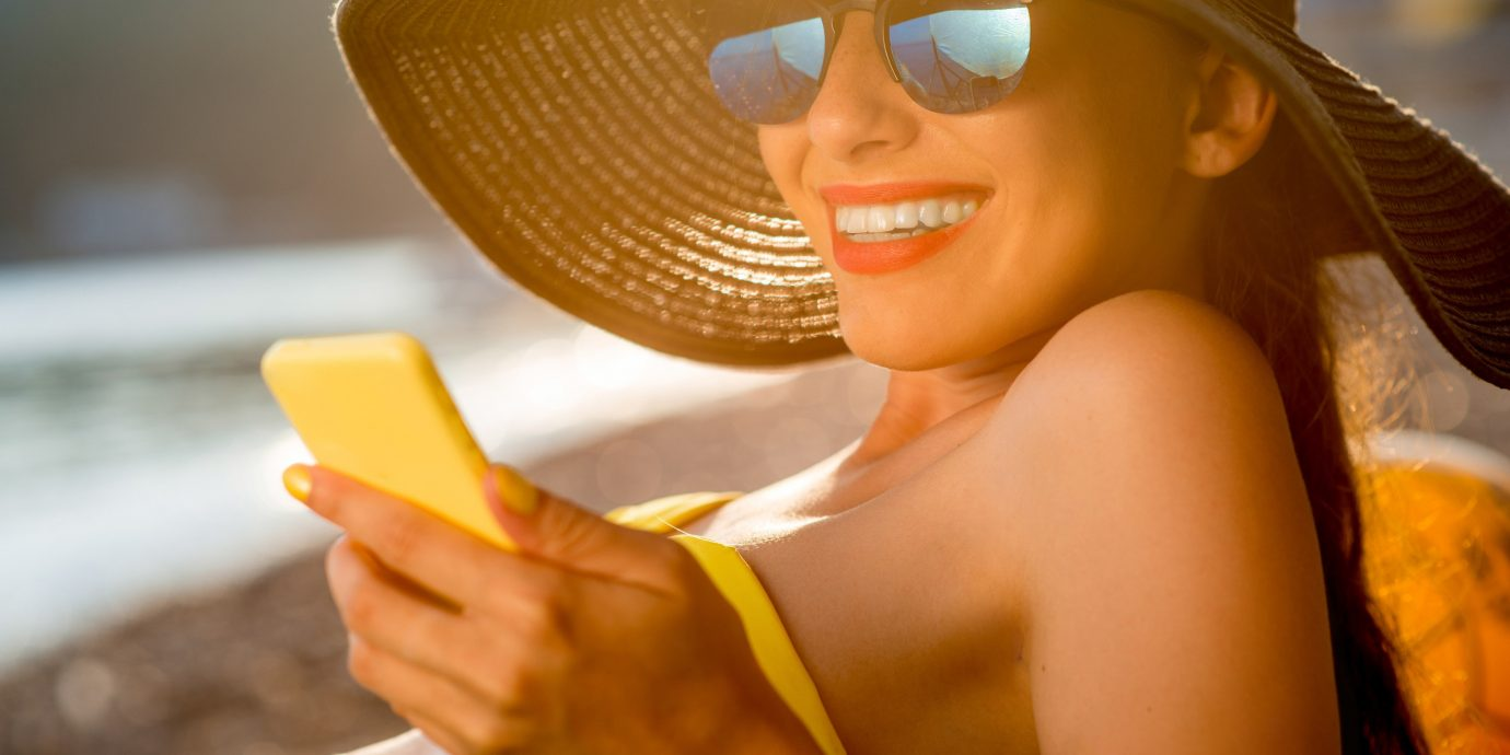 Travel Tips person color yellow eyewear Beauty glasses sunglasses girl blond smile skin head vision care finger model hand sense sun tanning photo shoot sweetness hat spectacles