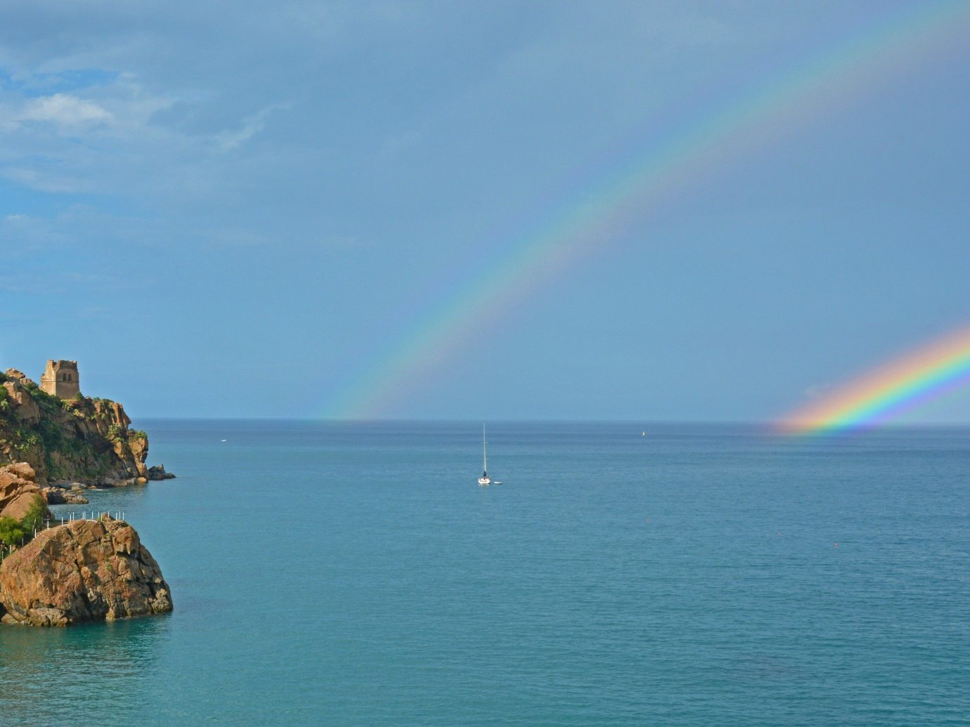 Trip Ideas water Nature outdoor sky rainbow horizon Sea Ocean meteorological phenomenon Coast bay Island distance