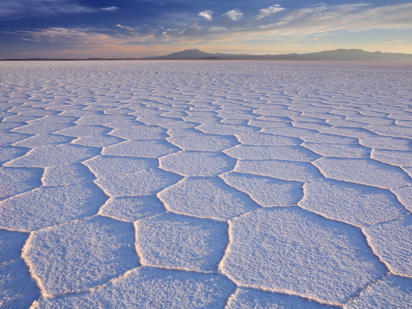 Trip Ideas sky outdoor horizon natural environment ecosystem road surface Sea plain mudflat sand soil Nature sunlight tundra arctic ocean frost salt evaporation pond salt lake arctic paving