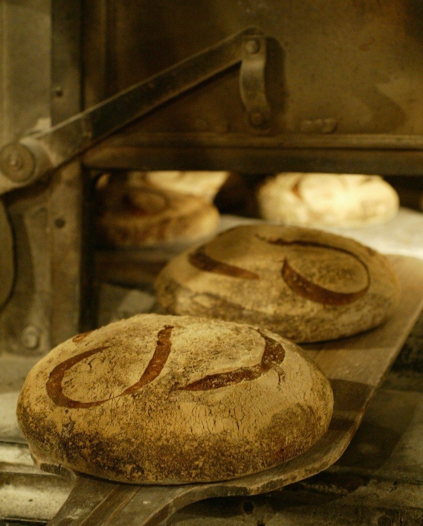 Food + Drink France Paris indoor food bread baking baked goods wood ancient history shape bakery