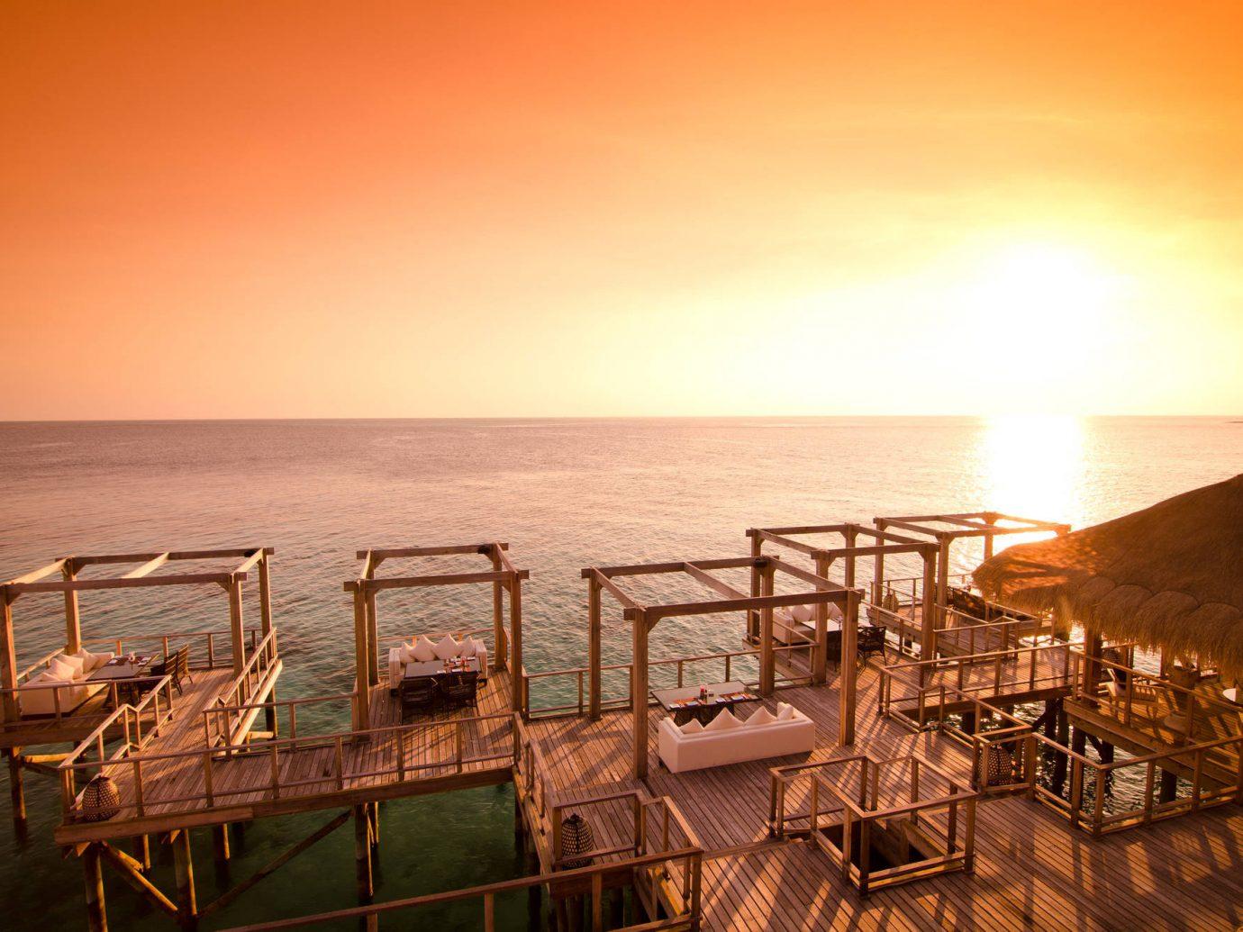 Hotels sky outdoor water Sunset Sea evening morning Ocean dusk sunrise set several