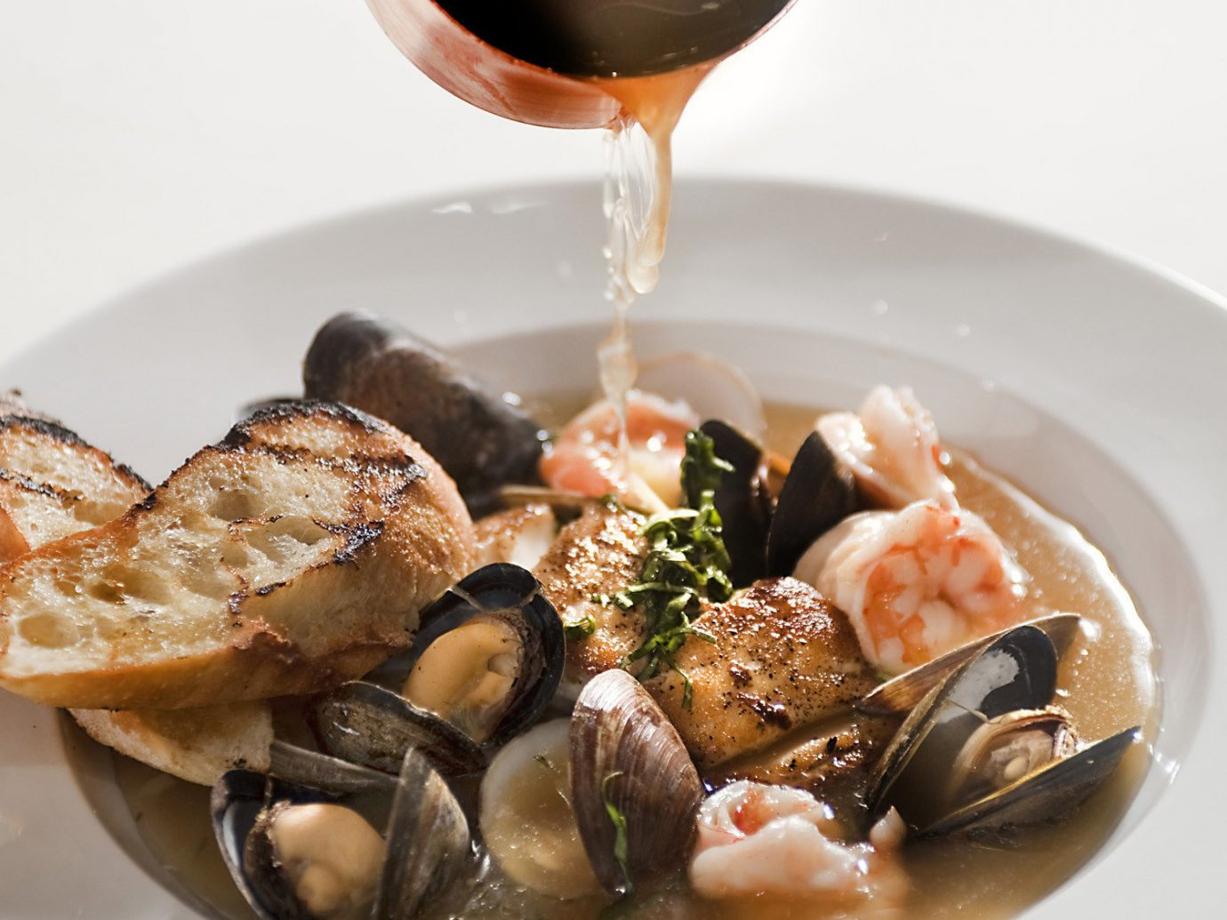Food + Drink plate food table dish meal bouillabaisse mussel cuisine Seafood fish restaurant escargot clam clams oysters mussels and scallops breakfast produce meat piece de resistance