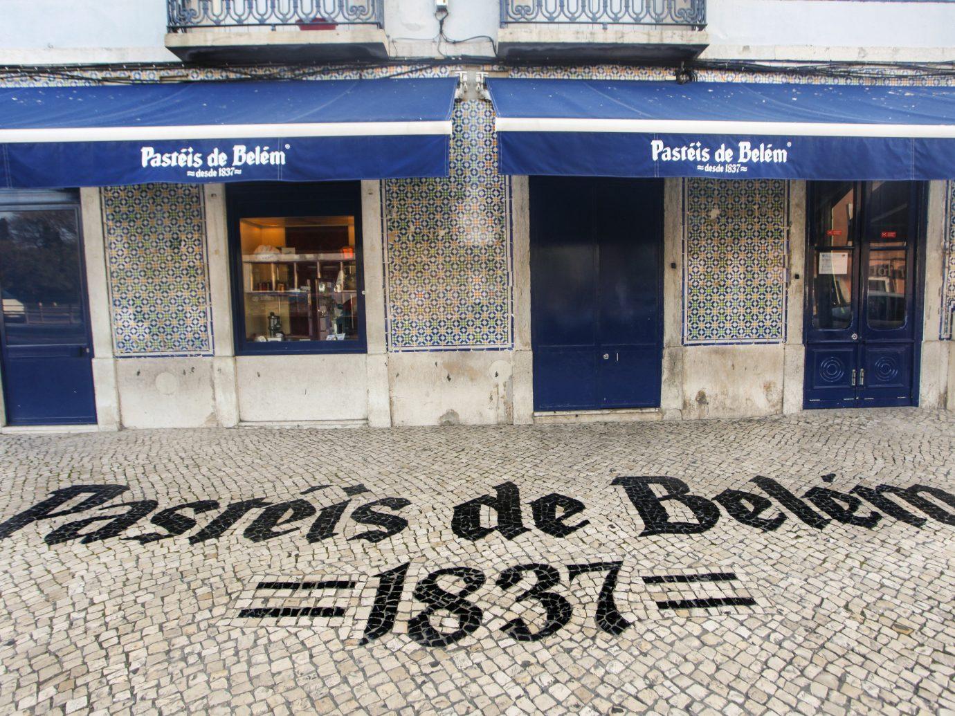 Lisbon Portugal Trip Ideas facade window building signage