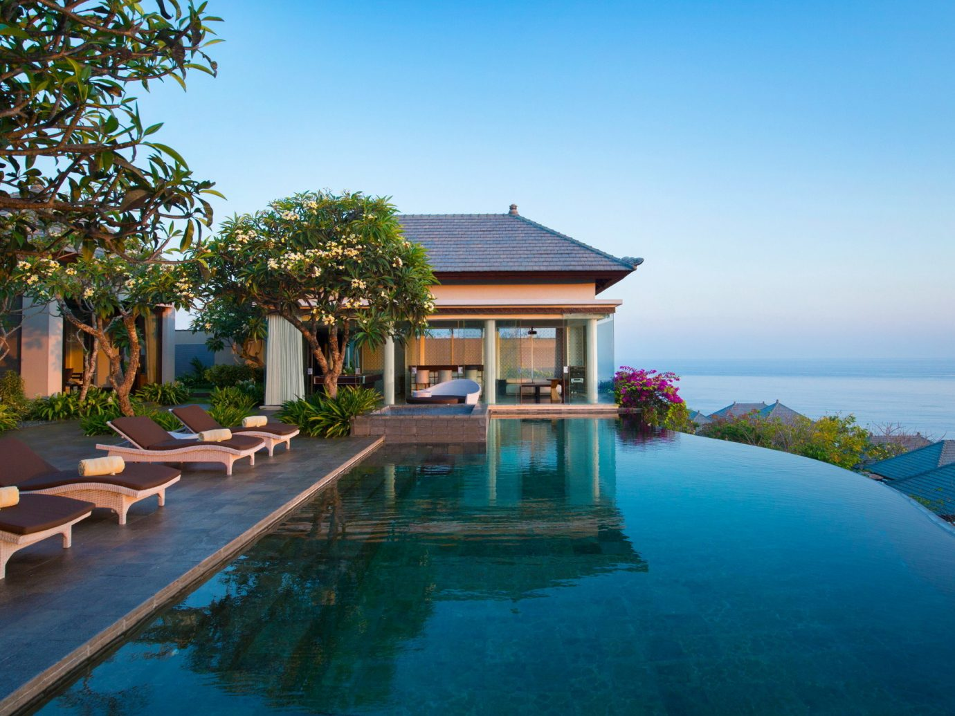 Hotels Jetsetter Guides Travel Tips Trip Ideas tree outdoor sky house water swimming pool property estate Resort leisure building Villa vacation home real estate mansion backyard condominium cottage residential
