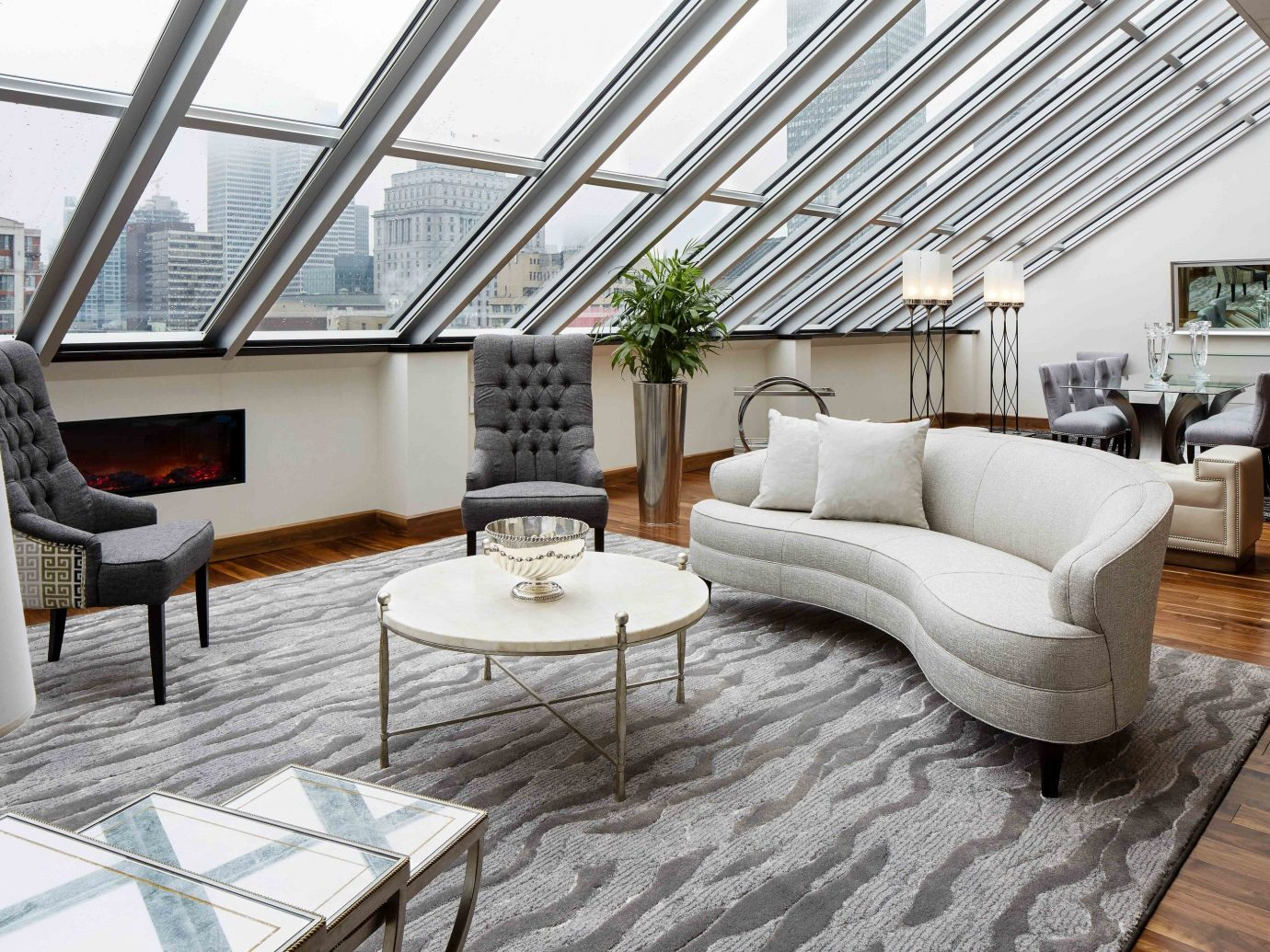 Canada Hotels Montreal Trip Ideas floor indoor Living room chair living room property Architecture interior design furniture real estate daylighting window penthouse apartment table loft roof house angle estate apartment flooring interior designer area
