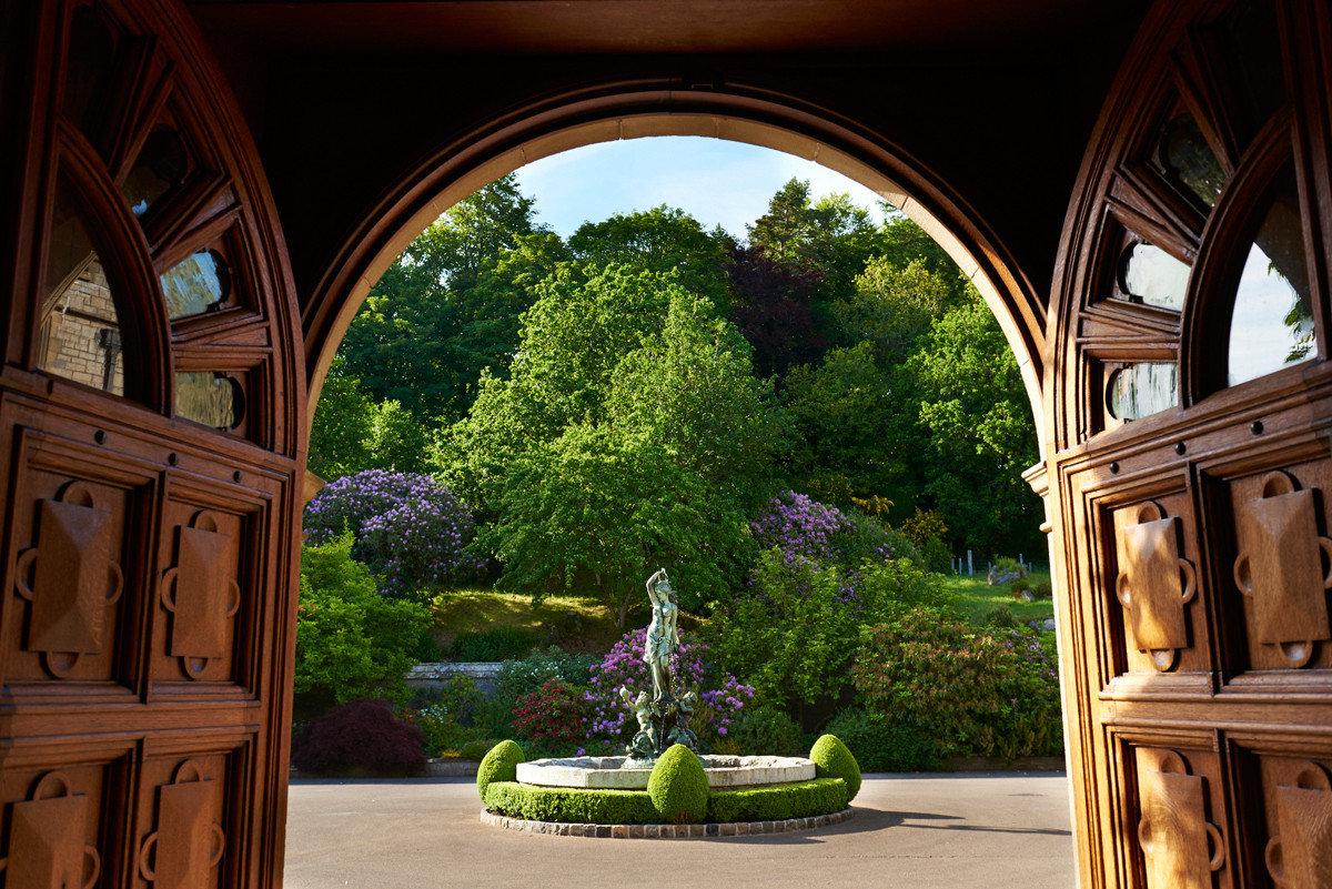 Hotels Romance Trip Ideas Weekend Getaways arch estate house Architecture home mansion Courtyard window wood Garden flower colonnade