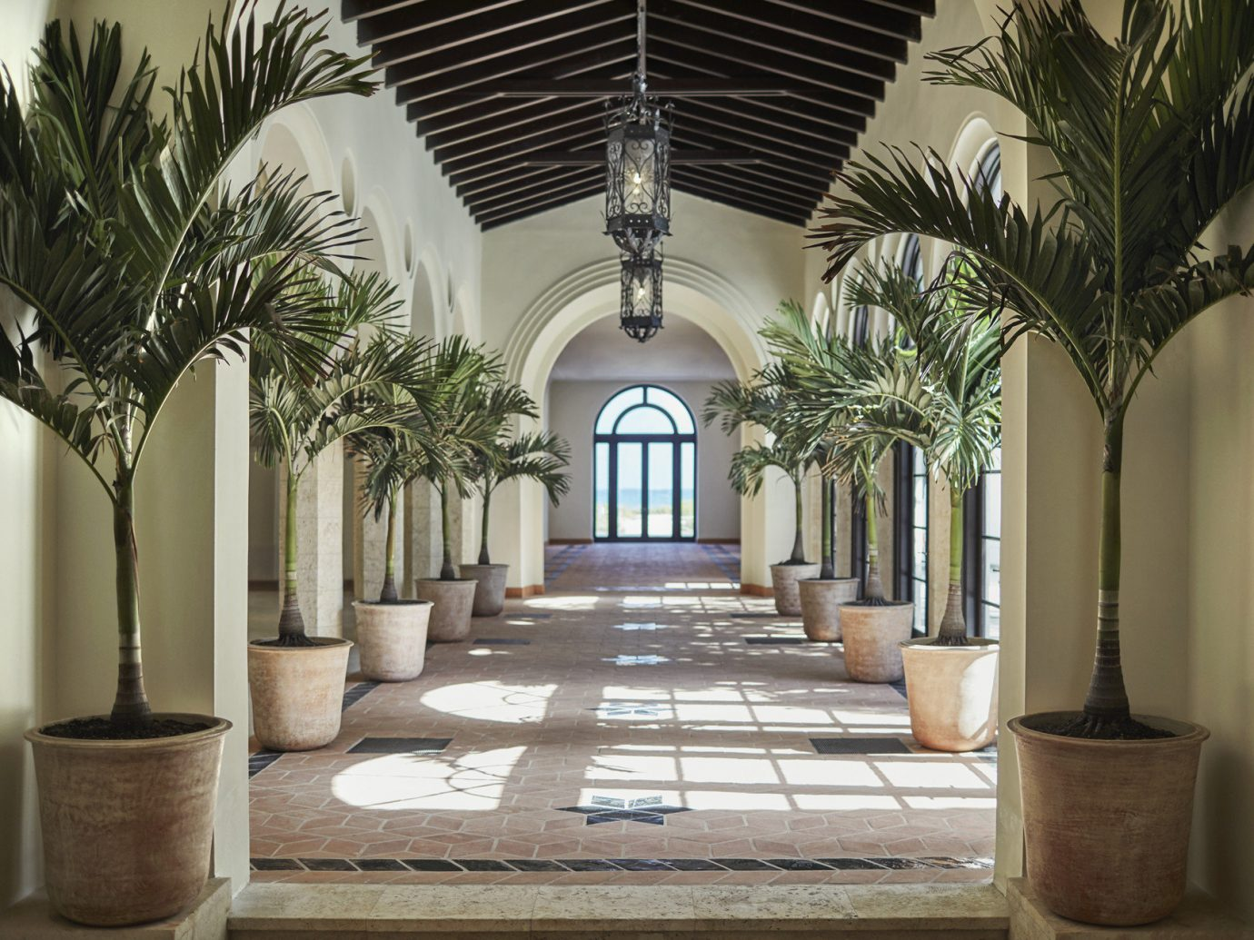 Hotels plant property estate building Architecture home Lobby mansion interior design palm Courtyard lighting arch column decorated hacienda hall Villa living room court furniture colonnade