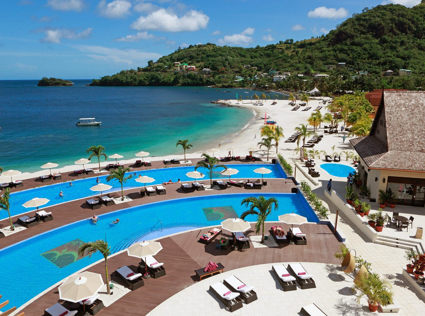 All-inclusive Beach Beachfront Exterior Family Grounds Lounge Patio Pool Resort Trip Ideas Tropical sky water outdoor leisure Nature vacation caribbean Sea tourism bay resort town Coast swimming pool estate Water park shore lined
