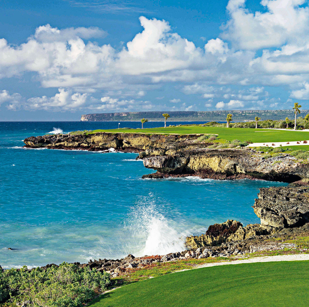 All-inclusive Golf Resort Travel Tips Waterfront sky water grass outdoor shore Sea Coast structure horizon Nature Ocean vacation Beach cloud sport venue bay cape landscape people islet cove aerial photography terrain golf course promontory day
