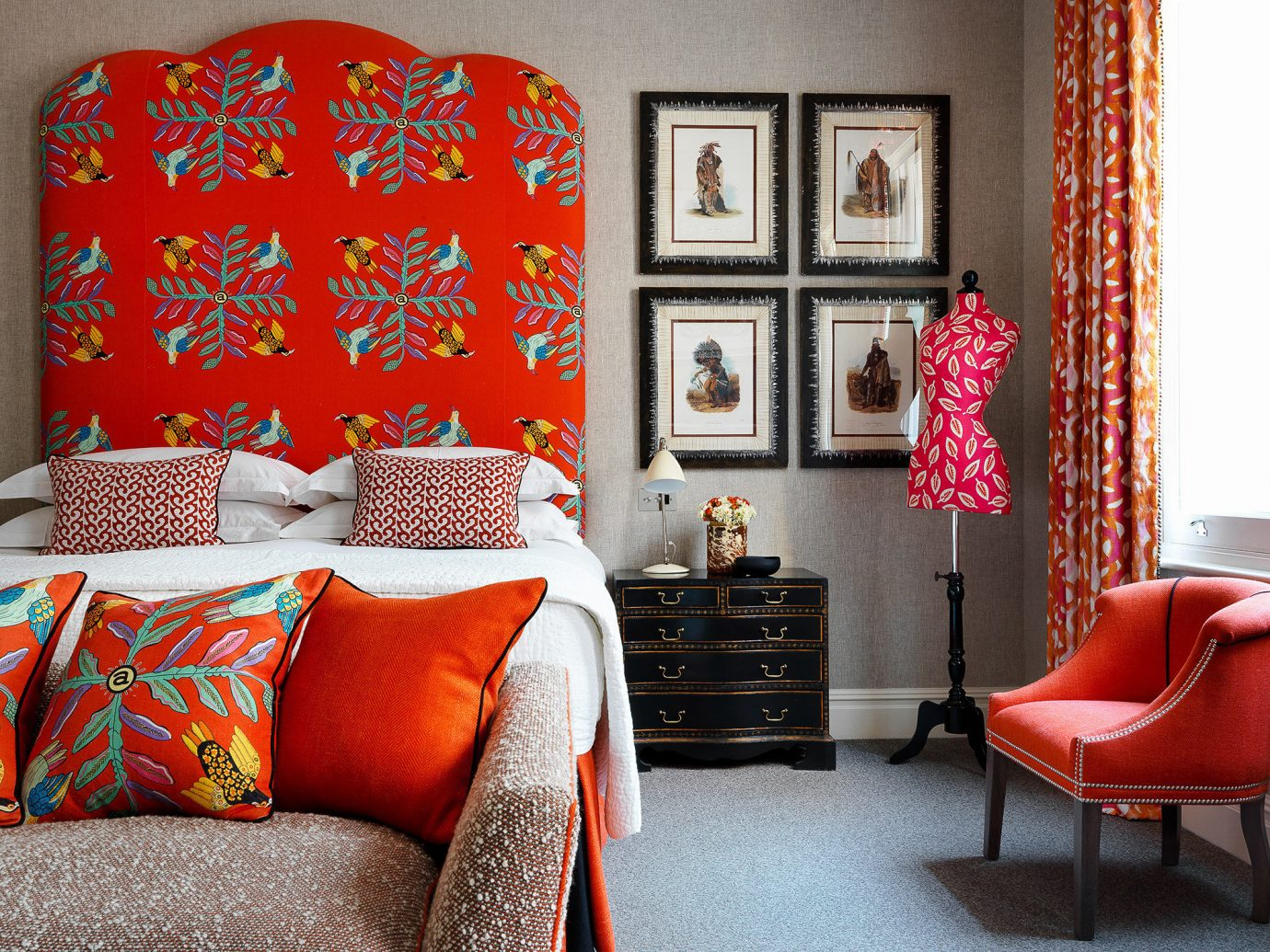 Boutique Hotels London Romantic Hotels red indoor room sofa floor chair living room Living interior design wall home textile colorful furniture pattern couch window Bedroom curtain decor linens orange bed sheet bright decorated table colored leather