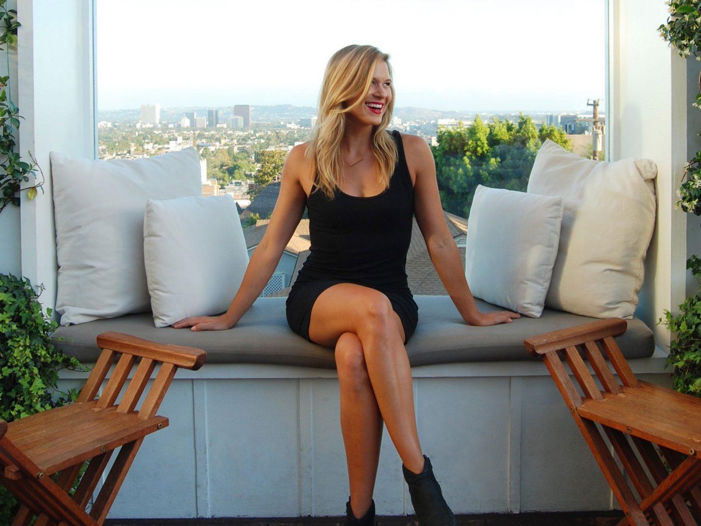 Hotels floor person woman sitting hair clothing human positions blond leg long hair brown hair photo shoot furniture