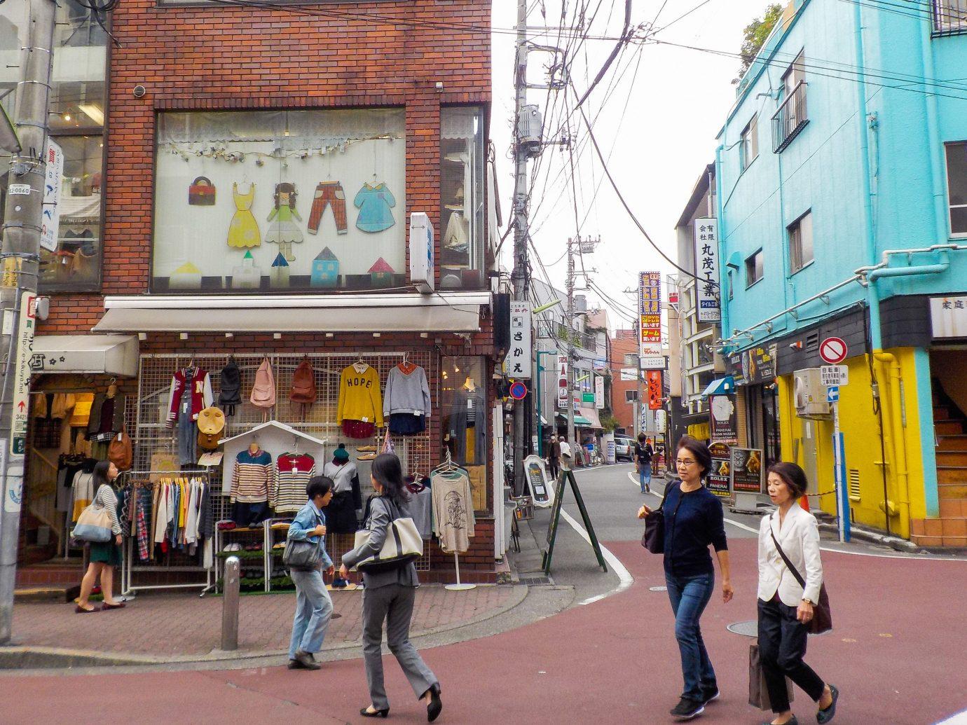 Trip Ideas outdoor building color road street crowd Town neighbourhood City pedestrian walking snapshot urban area human settlement people way tourism Downtown infrastructure shopping sidewalk