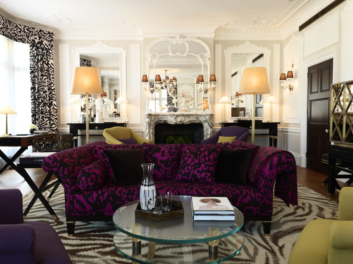 Hotels Travel Trends Trip Ideas indoor room Living sofa wall living room floor property chair dining room window furniture home estate interior design purple decorated real estate mansion area leather