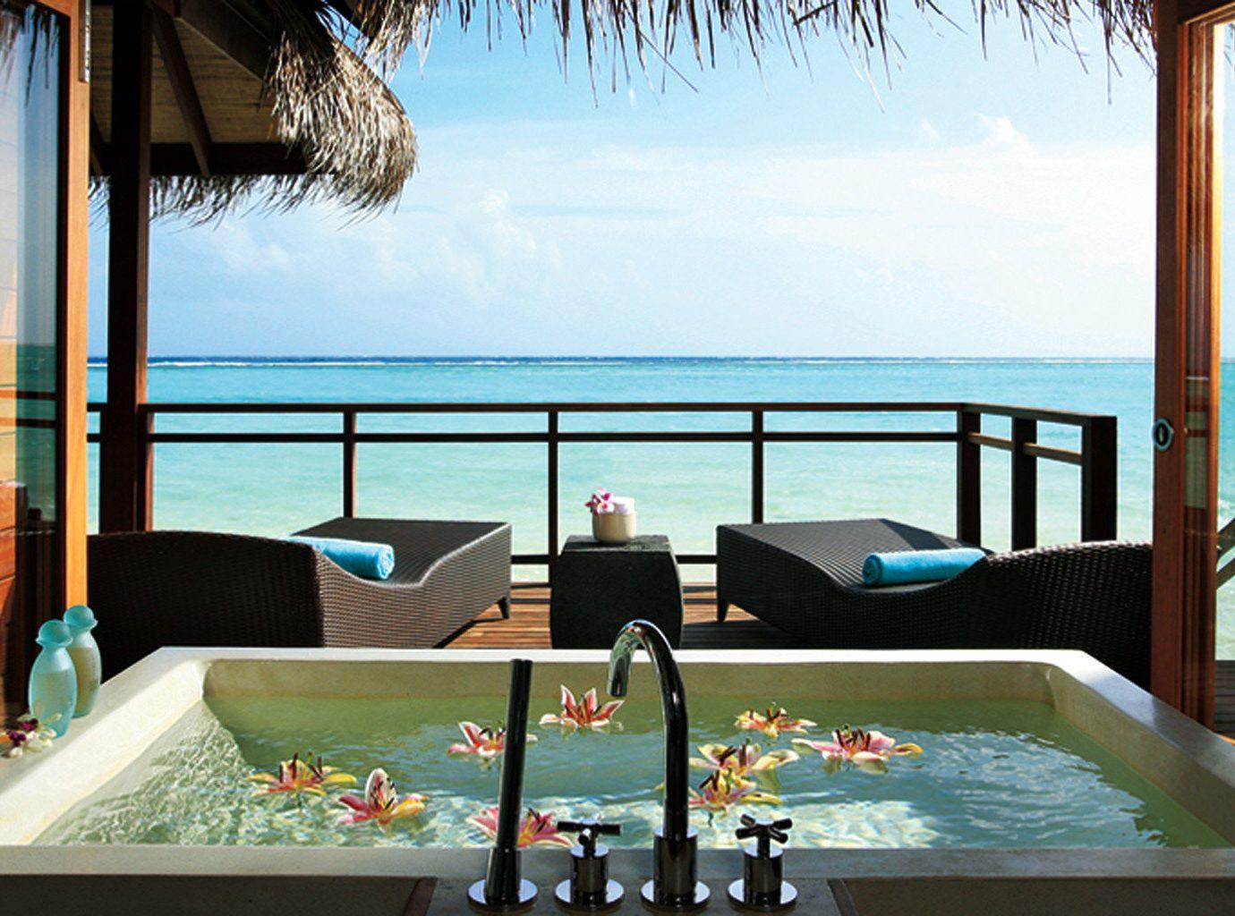 Outdoor bathtub at LUX* South Ari Atoll
