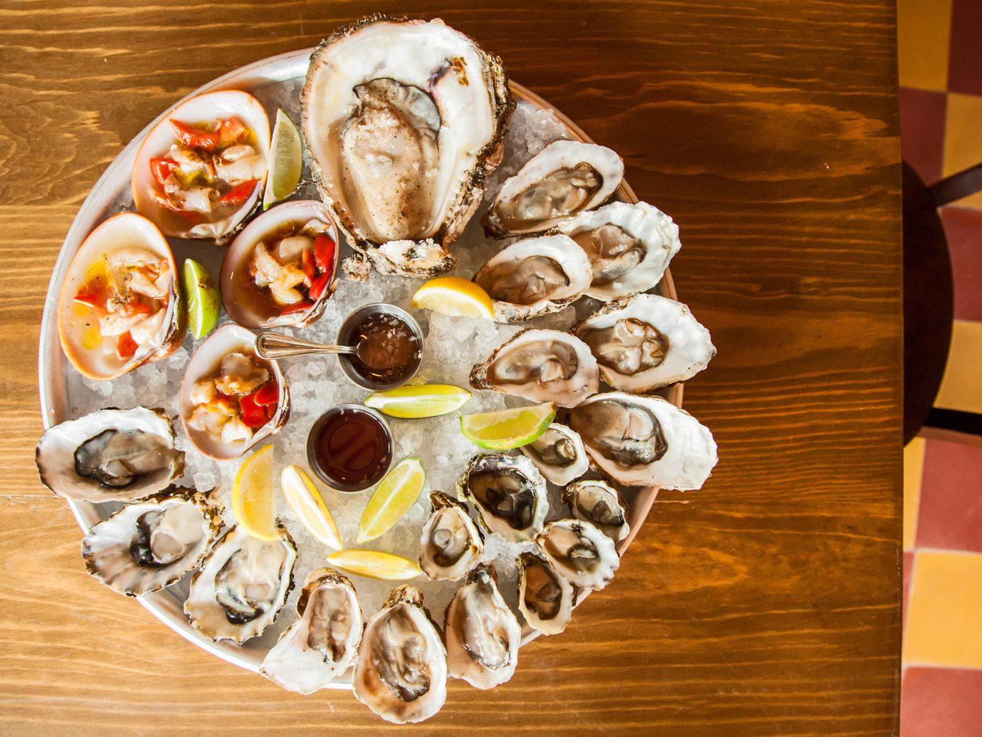 Trip Ideas table food indoor dish plate meal wooden Seafood cuisine produce dessert sliced