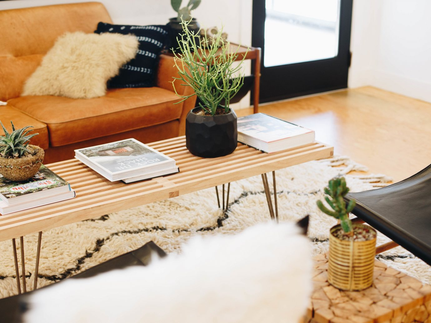 Hotels Style + Design Trip Ideas table indoor furniture living room home flooring coffee table wood floor interior design product design