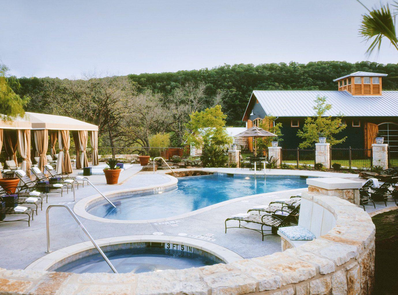Trip Ideas tree outdoor sky swimming pool property leisure estate Resort vacation Villa backyard home real estate mansion