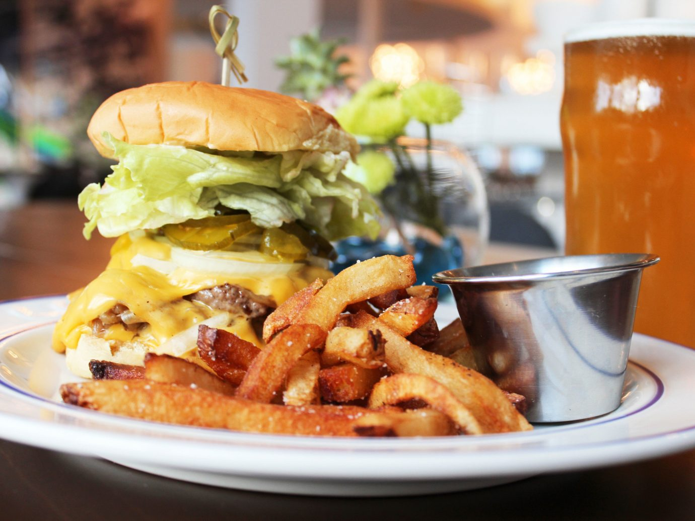 Trip Ideas table food plate cup dish hamburger meal indoor restaurant breakfast lunch french fries brunch Drink produce meat junk food sandwich fast food snack food close
