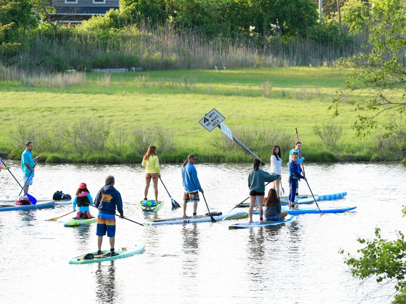 activities grass Greenery Lake Nature Outdoor Activities Outdoors paddleboarding people remote River Trip Ideas Water activities Water Sports outdoor tree Sport water canoeing boating vehicle watercraft rowing water sport Rowing paddle Boat waterskiing sports