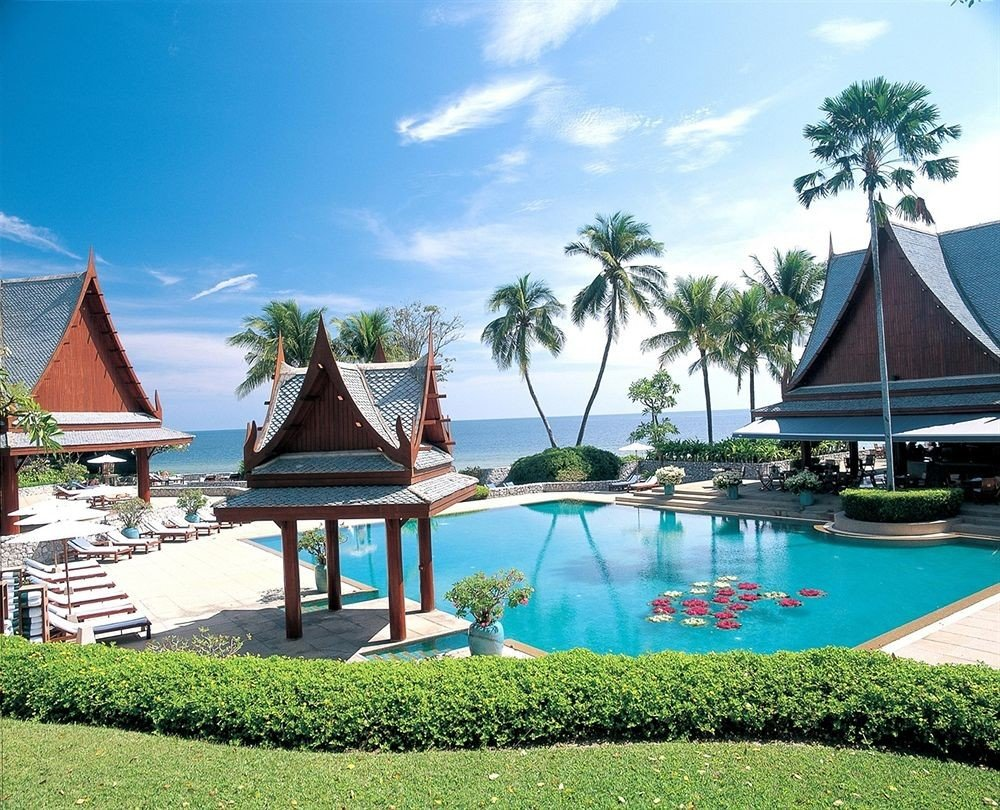 Hotels outdoor sky water house swimming pool leisure property Resort estate lawn vacation Villa mansion caribbean lined surrounded swimming Island several
