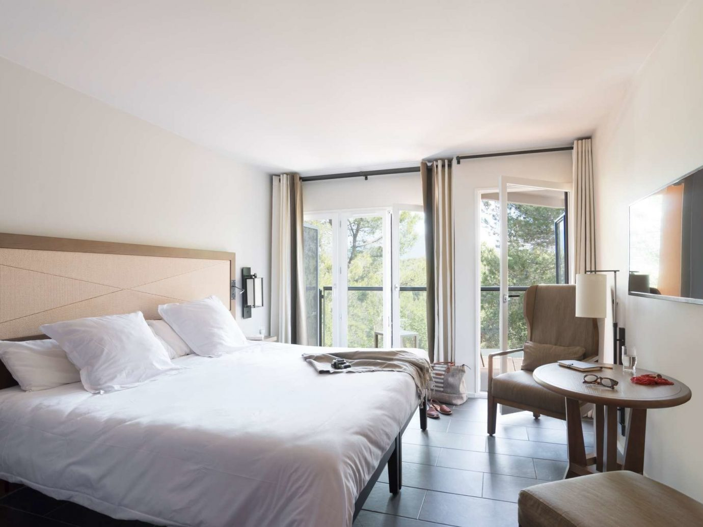 All-Inclusive Resorts Hotels indoor bed wall floor hotel room window ceiling Bedroom Suite interior design real estate white daylighting comfort boarding house interior designer