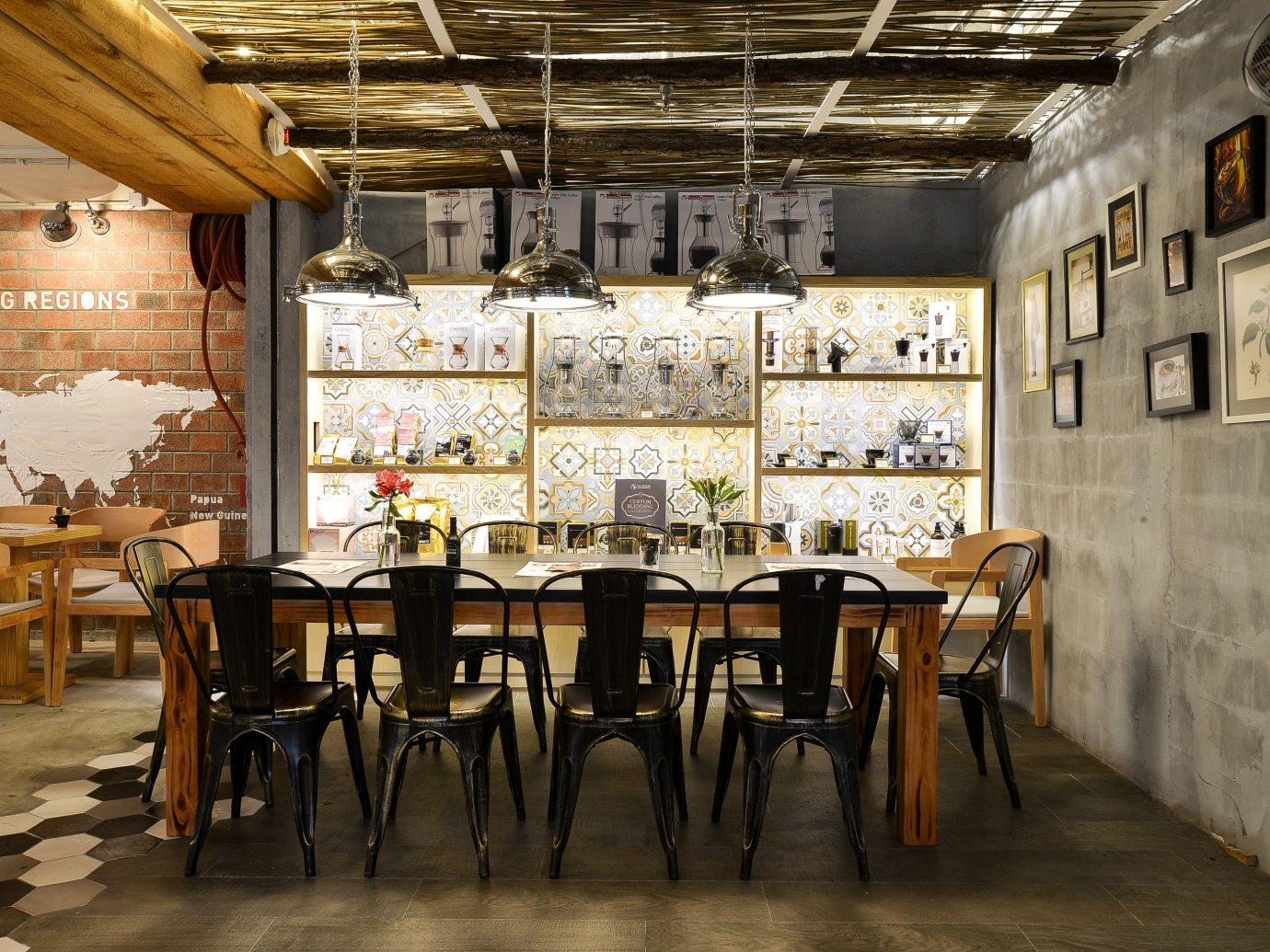 Food + Drink Offbeat Travel Trends floor indoor table chair interior design dining room restaurant furniture Dining café several