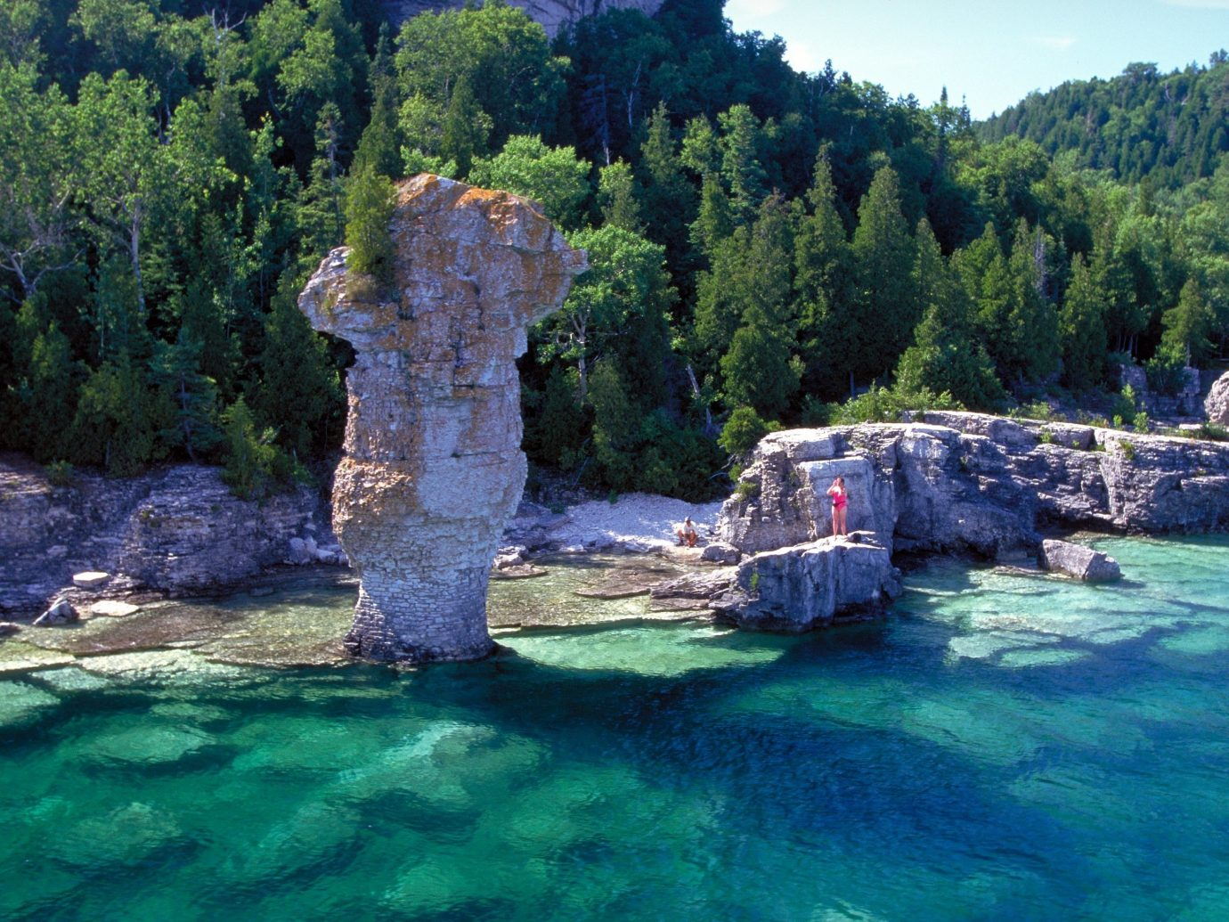 Fathom Five National Marine Park National Parks Outdoors + Adventure Trip Ideas tree outdoor water Nature landform geographical feature River Sea rock water feature Forest bay park terrain cliff rapid Lagoon national park surrounded wooded
