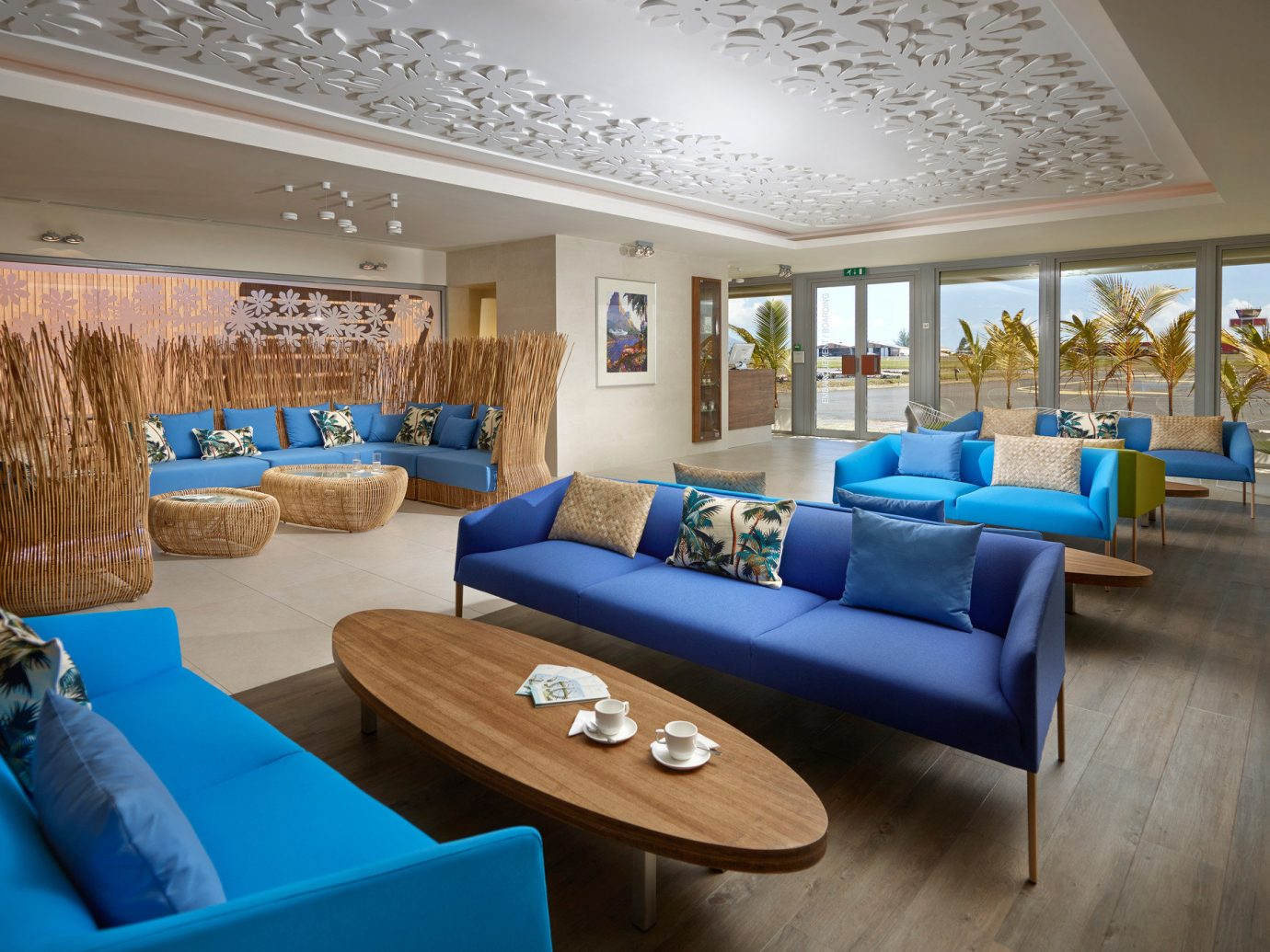 All-Inclusive Resorts Family Travel Hotels Tropical indoor Living floor ceiling sofa wall room window property furniture living room blue estate interior design home Villa Resort real estate Lobby Suite mansion wood area flat decorated Modern
