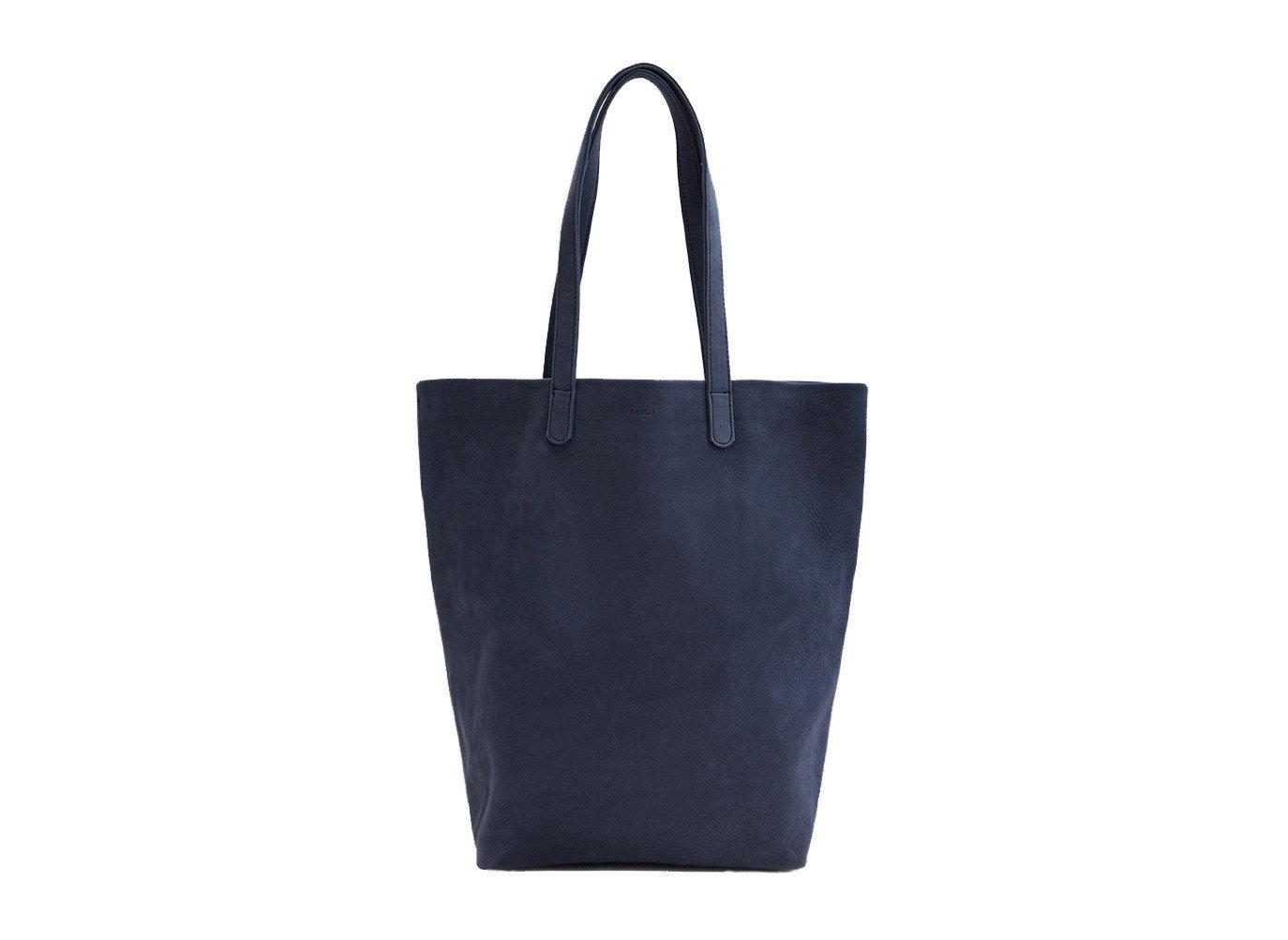 Packing Tips Style + Design Travel Shop Weekend Getaways handbag black bag shovel shoulder bag product leather tote bag product design brand accessory electric blue