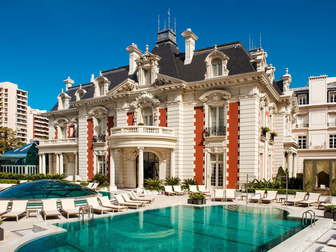 Boutique Hotels Luxury Travel building sky property outdoor mansion estate real estate palace classical architecture tourism tourist attraction Resort Villa facade plaza resort town swimming pool hotel leisure historic house stone colonnade