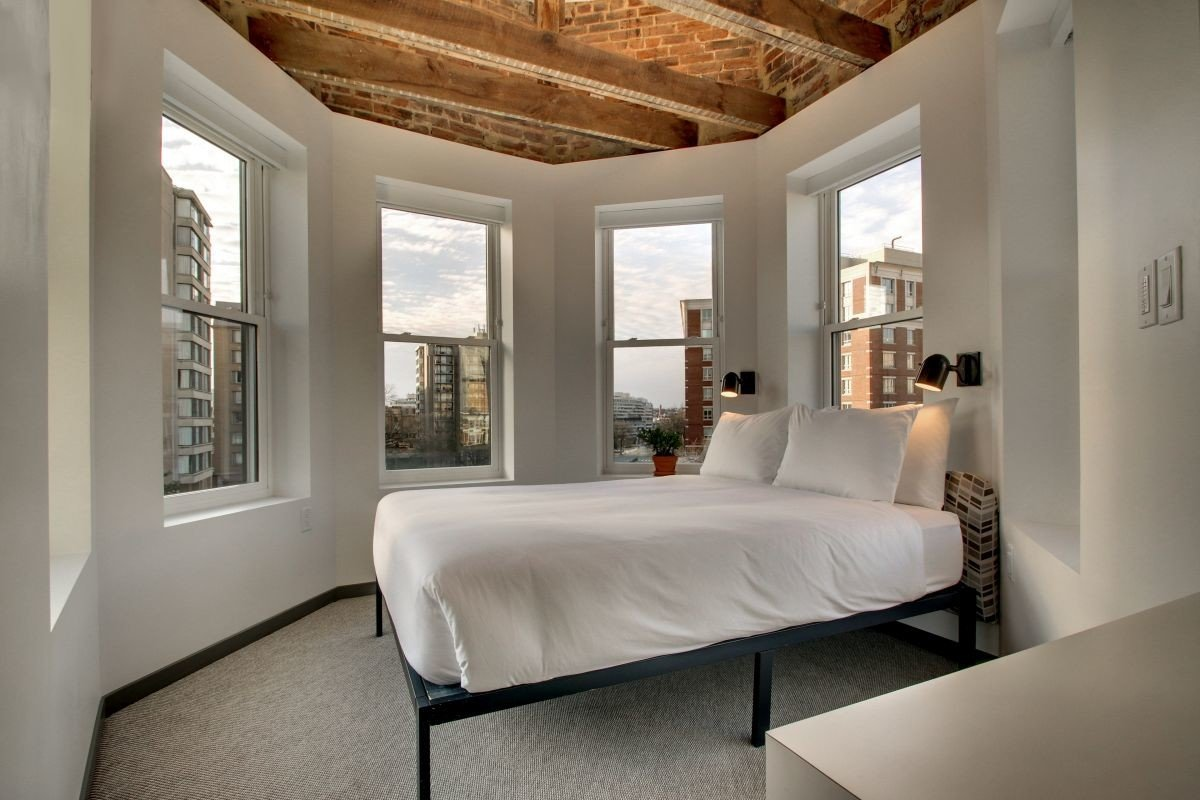 Boutique Hotels Hotels indoor floor wall window bed room ceiling interior design Bedroom Architecture bed frame home white estate real estate Suite interior designer daylighting flooring furniture