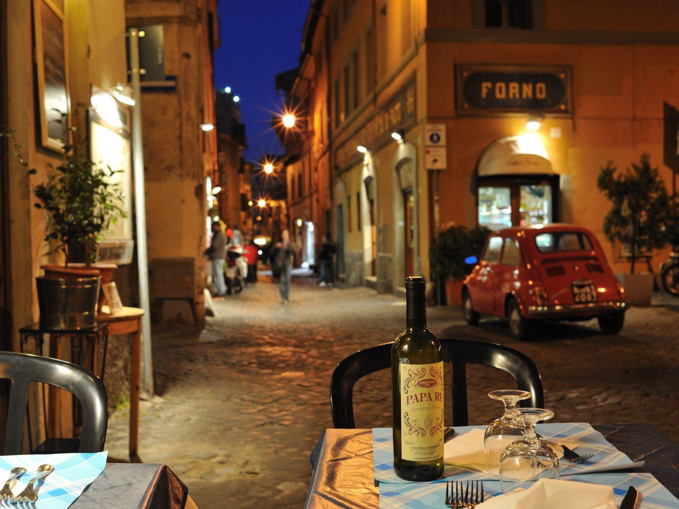 Travel Tips outdoor night street Town restaurant evening City window road