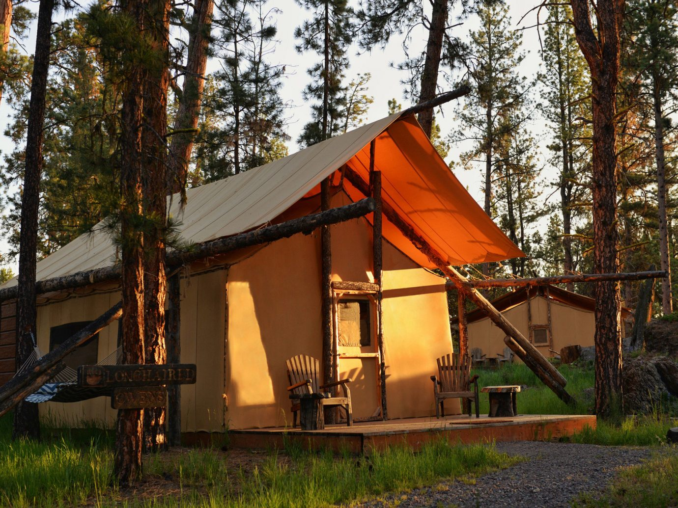 Road Trips Trip Ideas tree outdoor grass house log cabin building home hut shack cottage rural area estate outdoor structure several