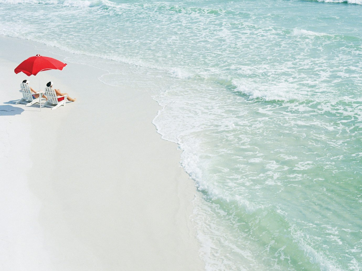Beach blue water couple sunbathing umbrella white sands water wind wave wave Ocean sports surfboard Sea Nature surfing equipment and supplies Coast extreme sport boardsport wind surface water sports surfing shore day