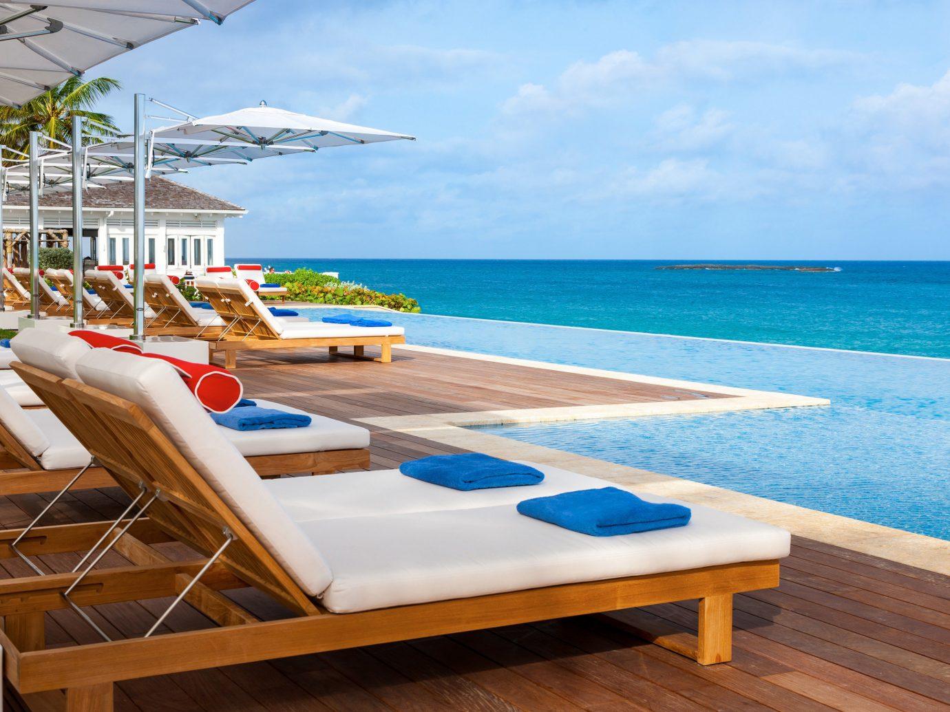 Hotels Romance Trip Ideas sky water chair outdoor leisure Beach property swimming pool vacation caribbean Resort Ocean Sea furniture estate Villa Deck