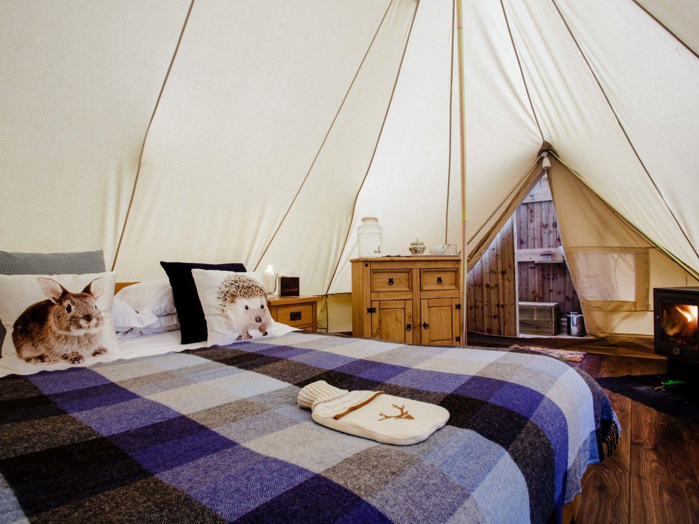 Glamping Outdoors + Adventure Trip Ideas room Bedroom bed interior design furniture Suite home estate floor ceiling flooring