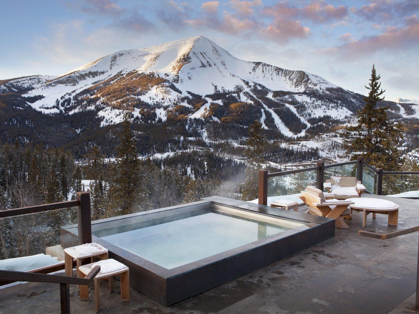 Beauty Hotels Luxury Travel Mountains + Skiing sky outdoor snow Winter weather mountain season Resort mountain range